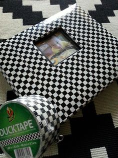 duct tape customized scrapbook cover. i used the checker board  duck tape to make cover. this will be my son's autograph book for monster jam and other monster truck or racing event
