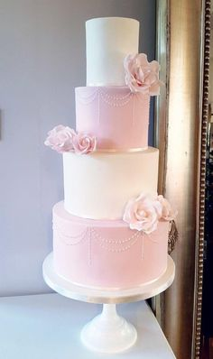 Blush pink and ivory rose wedding cake by Klis Cakery - http://cakesdecor.com/cakes/303725-blush-pink-and-ivory-rose-wedding-cake
