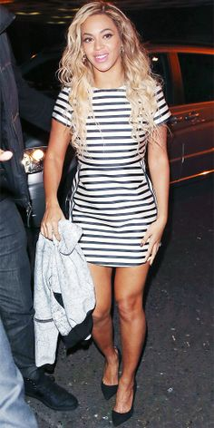 BEYONCE KNOWLES In between her Mrs. Carter Show World Tour performances, Beyonce took a break, stepping out in a striped satin Topshop dress...