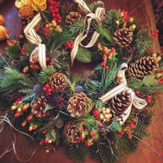 berry and pine cone wreath