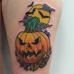 Cool pumpkin design tattoo concept for perfect fashion