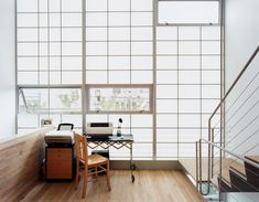 Modern home with Windows, Awning Window Type, and Metal. Clear glass panes set strategically into the otherwise translucent curtain wall expose the mezzanine to fresh air and rear views. Photo of Designing for Privacy: 14 Discreet Uses For Frosted Glass