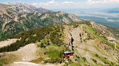 """Many people have """"see the Grand Tetons"""" on their bucket list, but they probably never thought they could see them like this. The Jackson Hole Aerial Tram takes you 4,136 vertical feet above Snake River Valley, Grand Teton National Park and the Gros Ventre Range. Did we mention the 360-degree views? But once you've recovered from the shock and awe of the amazing views, explore the topnotch restaurants, quirky shops and luxury resorts in town."""