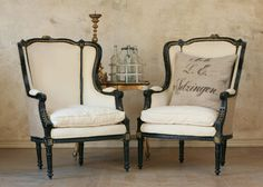 beautiful antique wingback chairs; black with cream fabric