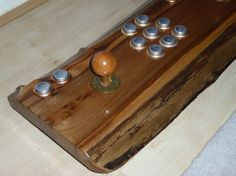 2 Player USB / PS3 Arcade Joystick - this one just on a nice piece of Character wood, with brass/silver coloured buttons, with an embossed font on the buttons.
