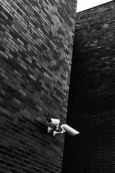 Fine Art Photograph in black and white surveillance cameras and dark brick stones Diy Home Security, Wireless Home Security Systems, Fine Art Photo, Photo Art, Local Police Station, Air Conditioning Units, Buy A Dog, Hiding Spots, Expensive Houses