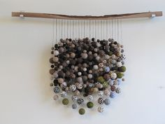"""""""Boletus"""" by Modern Fiber Lad - Sonya Yong James. She names this sculpture after spore prints from mushrooms she found, then created them in felt, strung on linen thread coated with beeswax and hung them from a piece of walnut. Wow."""