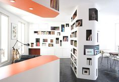 This is the coolest bookcase ever! Of course, it's French!  Contemporary-Apartment-Paris-00