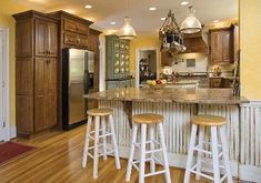 The stools would be great with an island for a casual, country feel. Very relaxed