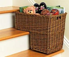 Staircase Basket: Keep your staircase free from random toys and small objects by storing them in this clever staircase basket. This uniquely designed basket is shaped so it perfectly fits in between two stairs, giving you an organized storage center so your staircase is clean and tidy.