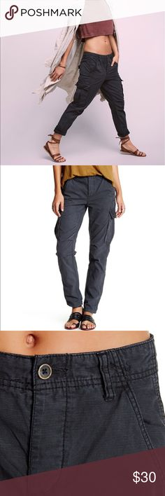 "Free People Wild Nothing Rugged Pants Free People Wild Nothing Rugged Pants. NWT. Color is black but its a faded black. Retail $98.   Easy and lightweight rugged cotton pants featuring cargo pockets and a button fly. Four-pocket style with belt loops at the waist.  Details - Zip fly with button closure - Slash pockets - Button flap back and cargo pockets - Slim fit - Tapered leg - Tonal topstitching - Approx. 10"" rise, 28"" inseam - Imported Fiber Content 100% cotton Ask all questions prior…"