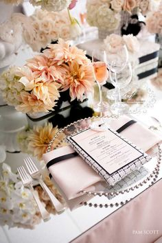 This table scape has a vintage Paris feel. The blush pink combined with black accents and garden flowers is the perfect, romantic table set up for your wedding reception.