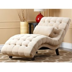 This cream-fabric chaise is sure to make a fashionable statement in your home or office. This chaise features an elegant, curved back and seat, a luxurious oak finish, and beautiful cream upholstery that completes its classy and modern look.