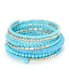 Look what I found on #zulily! Silver & Blue Beaded Coil Bracelet #zulilyfinds Polished beads and true blue hues create an eye-catching bracelet to don on any day that calls for a dash of panache.         1.75'' W x 2.5'' diameter     Silver-plated / glass