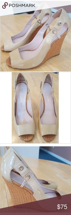 """ESCADA 38 Beige Patent Leather Wedges Heels Sandal Gorgeous wedge heels by Escada! Size 38 (European sizing) which I believe is equivalent to a US 8. Beige/ tan patent leather with open toe and rope-like material wedge heel. Made in Italy. Good pre-owned condition but they do have some scuffs/ spots that might come out with cleaner, and some wear to the outsoles, see pictures.  Heel: 4"""" in the back Length: approximately 9"""" Escada Shoes Heels"""
