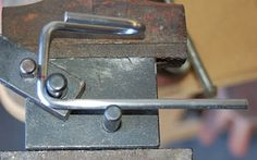 A second 90° bend completes the wire bending process.