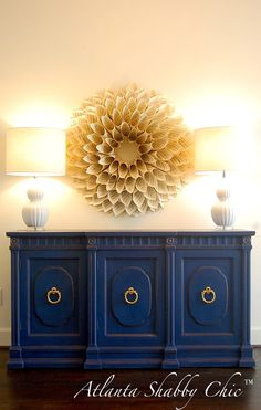 This antique buffet has been painted in Annie Sloan's Napoleonic Blue, with a distressed finish and sealed with clear wax.  This one is such a beauty!  Love the gold details and gorgeous brass hardware.  $695 - available at www.facebook.com/atlantashabbychic!