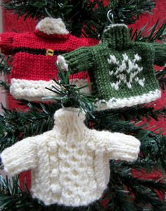 Free knitting pattern for tiny sweater ornaments. -  Awww! AND LOOK AT THE TEENY HANGERS FOR HOOKS!!!  I DIE!  lol  ♥A