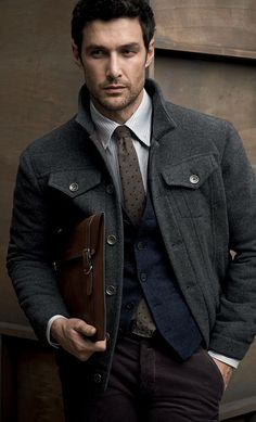 Grey Flannel Jean Style Jacket, Sweater Vest, and Dark Jeans. Men's Fall Winter Fashion.