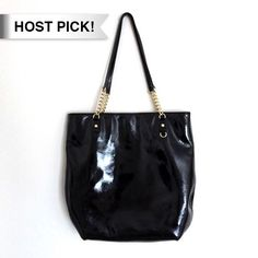 🎉HP!🎉Michael Kors black Jet Set patent leather Excellent condition. Great purse with lots of storage. Missing the MK Keychain, I didn't like having it on the bag and took it off and misplaced it. Gold hardware, signature lining. One outer pocket. Bundle to save 25%! Michael Kors Bags Totes