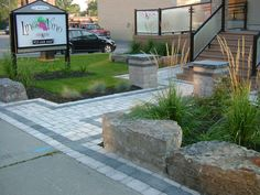 A commercial entrance doesn't have to have a commercial landscape!  We used a awsome combination of pavers, natural stone, plants and glass in this landscape!  http://www.facebook.com/LakeridgeContracting?ref=hl   http://www.youtube.com/user/LakeridgeContracting?feature=mhee
