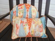 Patchwork Porch Pillows add a vibrant, refreshing touch to outdoor decor.