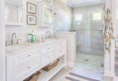 Master Bathroom: Roseland Project Renovation -- grey and white bathroom, home decorators Austell furniture vanity, Moen Banbury faucet, walk in shower, frameless shower door, Plum Pretty Sugar robe, grey shower tile, marble shower floor, EVER Skincare | Cute & Co.