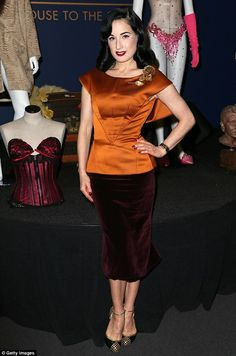 Signature style: Dita sported her signature vintage look for the event, accessorizing with...