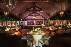 This barn-style structure is really a tent! It was made from scratch with a 60' by 100' tent and reclaimed wood.