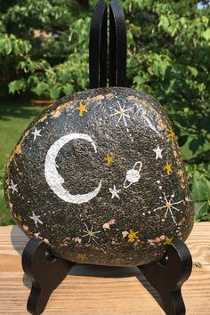 This Moonlit Night Sky hand-painted rock will make a one of a kind housewarming gift for that special friend, deserving teacher, gardener who has everything, or yourself. If you like what you see in the pictures and video, you'll be pleasantly surprised when you receive the rock and take a close look at the natural black background. It is painted on both sides leaving the choice of view up to you. Painted Rocks For Sale, Hand Painted Rocks, Night Skies, Black Backgrounds, Picture Video, Etsy Store, House Warming, Take That, Stars