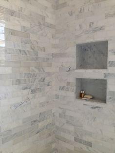 Portfolio - Rice Construction Group marble tiles with inset shelves. ...shared by Vivikene