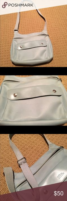 Authentic Longchamp Crossbody Messenger Bag Nylon with leather trim. Adjustable cross body strap. Full top zip closure with front flap double snap closure pocket. Good condition with normal wear. Baby blue color Longchamp Bags Crossbody Bags