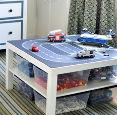 Lego road plates + IKEA Lack table = Lego organization and cool play table all in