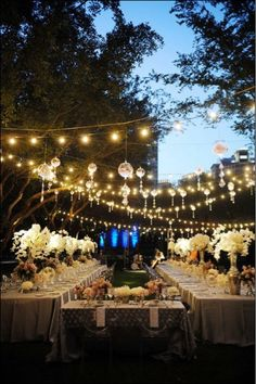 Wedding reception canopy... Love the sting of lights and the orbs hanging from the stings