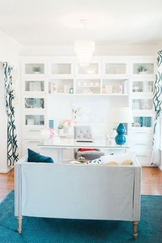 White home office with turquoise highlights