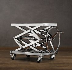 Industrial Scissor Lift Table Polished Nickel - Reminds me of a steam engine! I'm thinking a couple glasses of whiskey will look nice on this ;)
