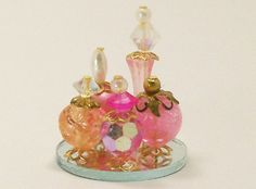 Dollhouse Miniature Perfume Bottle Collection Pink Passion Rose Pink Lustre One Inch Scale, via Etsy.