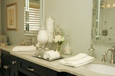 Using clear containers of varying heights for the toiletries you provide makes them easy to identify and adds flair to the counter top.
