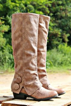 They are a synthetic leather on the exterior with a super soft microfiber interior. They feature detailing throughout with a 'fold over' design near the ankle with two large buttons on the exterior with a heel. Cowgirl Boots, Western Boots, Taupe, Wedding Boots, Snow Wedding, Cute Boots, Sexy Boots, Women's Boots, High Boots