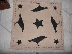 Primitive Stenciled Crows and Stars Candle Mat.