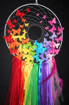 Large rainbow butterfly dream catcher  Made on 30 cm base wrapped in satin ribbon together with web from white silk thread Finished off with a combination of ribbons Includes combination of different styles, designs and sizes butterflies which may differ from those on the photo Can be personalized with a name on request ( please contact me for custom listing )  Available in 15 cm; 20 cm; 25 cm and 30 cm base hoop  Monitor colors and brightness vary and may be slightly different than the true…