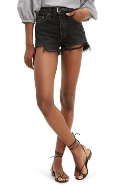 Shredded hems and strategic whiskering add to the worn-in feel of nonstretch denim shorts designed with a button fly and an edgy summertime look. Style Name:Levi's 501 Original Cutoff Shorts (Wise Up). Style Number: Available in stores. Black Shorts Outfit Summer, Camo Shorts Outfit, Black Levi Shorts, Denim Cutoff Shorts, Black Levis, Levis 501, Jean Short Outfits, Nordstrom, Summertime