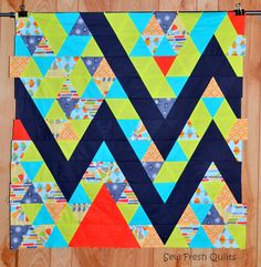 Sew Fresh Quilts: MQG Fabric Challenge Made completely from equilateral triangles, all the same size, and fat 1/8ths of fabric Design layout at this link:  https://m.flickr.com/#/photos/sewfreshquilts/14214490078/
