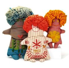 Plush dolls with embroidered bodies and yarn hair. Can't decide where to pin them!