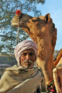 Hindu Man & His Camel in India