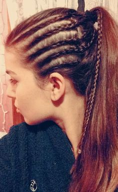 Cornrows and a ponytail!