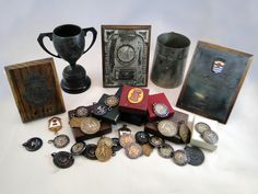 297) Large collection of 35 London County and other swimming, diving, water polo medals and 5 trophies including silver 1951 inter-services team medal, silver and oak trophy (40) Est. £50-£70