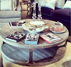 Circular Rustc Wooden Coffee Table---like this but it would need to be on wheels or something....