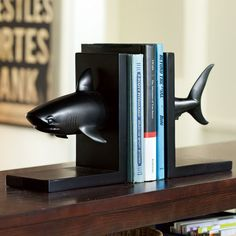 Clayton has a shark. I wonder if I could get away with cutting it in half for some bookends?!
