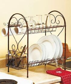 Deluxe Dish Racks Sure, you can dry your dishes on this. Now, what about STORING lovely everyday dishes in this rack? Clear cabinet space for the ugly, everyday stuff, while beautifying the kitchen with the dishes you loved for their pattern. New Kitchen, Kitchen Dining, Kitchen Decor, Kitchen Ideas, Kitchen Organization, Kitchen Storage, Lakeside Collection, Everyday Dishes, Iron Furniture